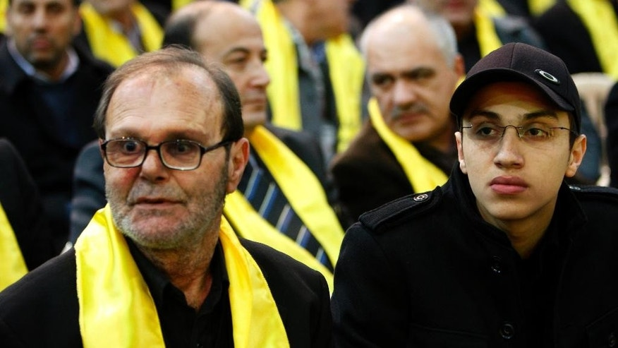 FILE - In this Feb. 16, 2009, file photo, Fayez, left, father of Imad Mughniyeh, and Jihad, the son of slain top Hezbollah's commander Imad Mughniyeh, attend a rally commemorating the first anniversary of Imad Mughniyeh's assassination in the southern suburb of Beirut, Lebanon. A Hezbollah official said Sunday, Jan. 18, 2015, that an Israeli strike in the Syrian Golan Heights killed Jihad Mughniyeh and four other fighters from the Lebanese Shiite militant group. (AP Photo/Hussein Malla, File)