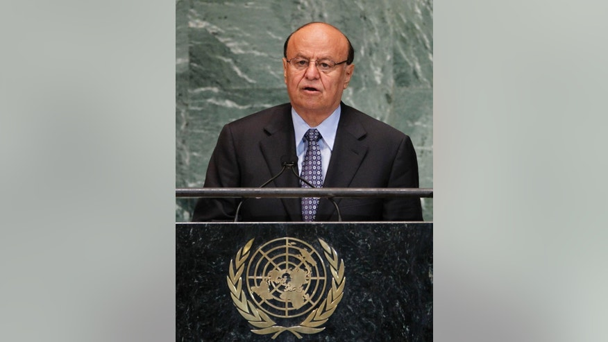 File-This Sept. 26, 2012, file photo shows Abed Rabbo Mansour Hadi, President of Yemen, as he addresses the 67th United Nations General Assembly, at U.N. headquarters.  Witnesses say rebel Houthi militiamen are battling soldiers near Yemen's presidential palace. The status of President  Hadi was not immediately clear.The battle began early Monday, Jan. 19, 2015. Witnesses say they heard heavy machine gun fire and mortars falling in the neighborhood. Civilians in the area fled the fighting. (AP Photo/Jason DeCrow, File)