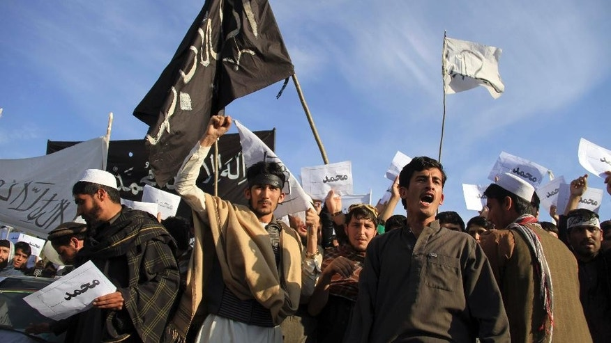 Afghan university students chant slogans during a protest against caricatures published in French magazine Charlie Hebdo in Jalalabad, east of Kabul, Afghanistan, Sunday, Jan. 18, 2015. (AP Photo)