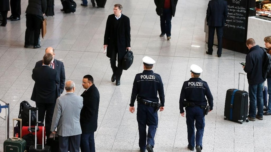 German police officers patrol in a terminal at the airport in Frankfurt, Germany, Monday, Jan. 19, 2015. Security concerns across Europe have been heightened following the terror attacks in Paris, in which 17 people were killed. (AP Photo/Michael Probst)