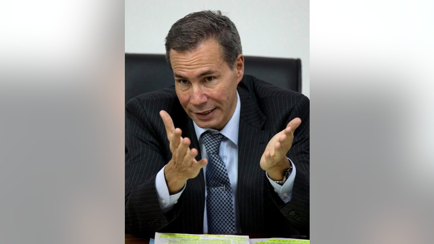 FILE - In this May 29, 2013 file photo, Alberto Nisman, the prosecutor investigating the 1994 bombing the Argentine-Israeli Mutual Association community center, talks to journalists in Buenos Aires, Argentina. In a statement released Wednesday, Jan. 14, 2015, Argentine Prosecutor Alberto Nisman, who was investigating the 1994 bombing of the Jewish community center and accused President Cristina Fernandez of reaching a deal with Iran to avoid punishing those responsible. was found dead late Sunday Jan. 18, 2015 in his apartment in Buenos Aires, officials said. Nisman was due to participate in a closed-door session with Congress Monday.(AP Photo/Natacha Pisarenko, File)