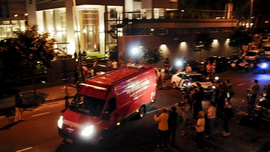 An ambulance carrying the remains of prosecutor Alberto Nisman leaves the area outside his apartment in Buenos Aires, Argentina, early Monday, Jan. 19, 2015.  Special prosecutor Alberto Nisman who accused the government of secret deals with Iran over an investigation into a 1994 terrorist attack was found dead, officials said early Monday. He was due to participate in a closed-door session with Congress Monday over his claim last week that de Kirchner and Foreign Minister Hector Timerman covered up a deal with Iran.(AP Photo/Pablo Aharonian-DyN)