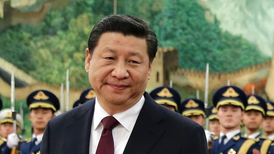 FILE - In this Dec. 23, 2014 file photo, Chinese President Xi Jinping walks during a welcome ceremony for Egyptian President Abdel-Fattah el-Sissi, at the Great Hall of the People in Beijing, China. China's leadership has issued guidelines requiring universities to strengthen ideological controls in classrooms and telling professors to champion Marxism, traditional culture and socialist core values. The orders come as President Xi tightens his grip on political power and cracks down on the encroachment of supposed Western values such as press freedom and civil society groups. (AP Photo/Andy Wong, File)