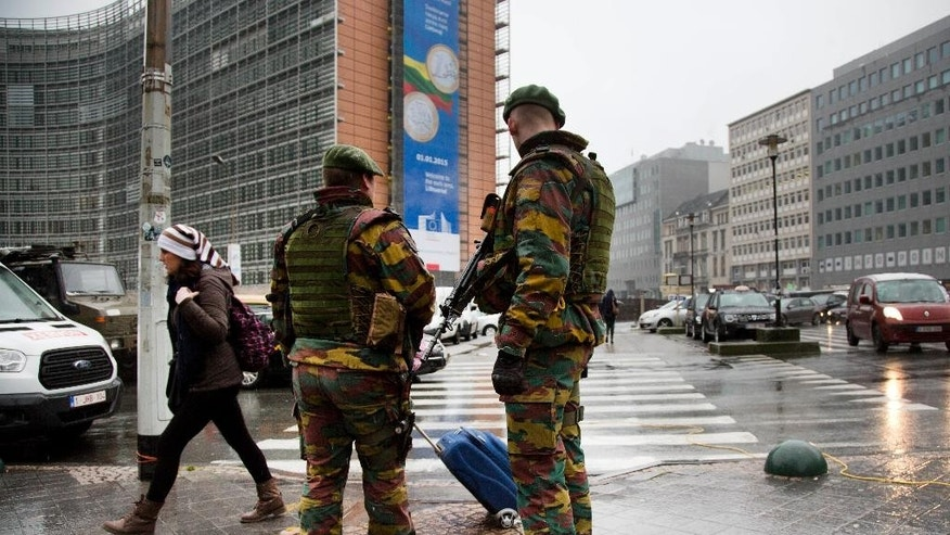Belgian soldiers patrol in front of EU headquarters in Brussels on Monday, Jan. 19, 2015. Security has been stepped up after thirteen people were detained in Belgium in an anti-terror sweep following a firefight in Verviers, in which two suspected terrorists were killed. (AP Photo/Virginia Mayo)