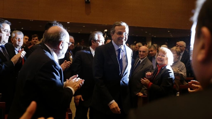 Conservative Prime Minister Antonis Samaras arrives at the Athens Chamber of Industry and Commerce to make an election campaign speech, in Athens on Monday, Jan. 19, 2015. Samaras' New Democracy party has failed so far to overcome a gap in opinion polls with the anti-bailout Syriza party ahead of the Jan. 25 general election. (AP Photo/Thanassis Stavrakis)