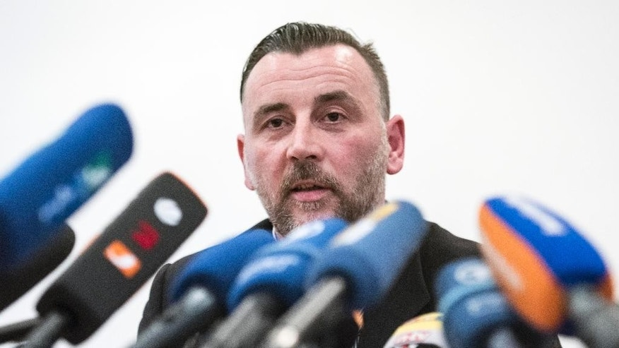 "Organizer Lutz Bachmann, speaks during  a news conference of the group 'Patriotic Europeans against the Islamization of the West' (PEGIDA) in Dresden, Germany, Monday, Jan. 19, 2015. The German group protesting what it calls ""the Islamization of the West"" is vowing that it won't be silenced after its weekly rally was canceled because of a terrorist threat against one of its organizers. The planned demonstration in Dresden  was scrapped and local police banned all rallies Monday after being informed of a call for attackers to kill Lutz Bachmann,  PEGIDA's best-known figure.  (AP Photo/Jens Meyer)"