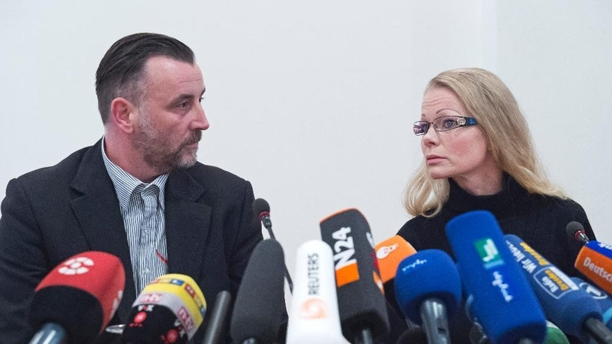 "Organizer Lutz Bachmann, left,  and co-organizer  Kathrin Oertel  attend  a news conference of the group 'Patriotic Europeans against the Islamization of the West' (PEGIDA) in Dresden, Germany, Monday, Jan. 19, 2015. The German group protesting what it calls ""the Islamization of the West"" is vowing that it won't be silenced after its weekly rally was canceled because of a terrorist threat against one of its organizers. The planned demonstration in Dresden  was scrapped and local police banned all rallies Monday after being informed of a call for attackers to kill Lutz Bachmann,  PEGIDA's best-known figure.  (AP Photo/Jens Meyer)"