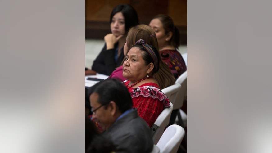Rigoberta Menchu, a Nobel Peace prize winner, listens as the judge reads the verdict for former police officer Pedro Garcia Arredondo who was found guilty of murder and sentenced to 90 years in prison in Guatemala City, Monday, Jan. 19, 2015. Arredondo was found guilty for the murder of 37 people who died in the 1980 attack and burning of Spain's embassy, including Menchu's father. According to testimony during the trial, civilians broke into the embassy on Jan. 31, 1980 to denounce alleged atrocities by the army in their communities during Guatemala's civil war. (AP Photo/Moises Castillo)