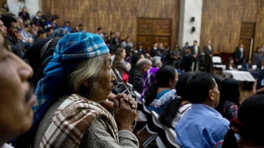 An indigenous woman listens to the judge read the verdict for former police officer Pedro Garcia Arredondo who was found guilty of murder and sentenced to 90 years in prison for the deaths of 37 people in a 1980 attack and burning of Spain's embassy in Guatemala City, Monday, Jan. 19, 2015. According to testimony during the trial, the attack happened after civilians broke into the embassy on Jan. 31, 1980 to denounce alleged atrocities by the army in their communities during Guatemala's civil war. (AP Photo/Moises Castillo)