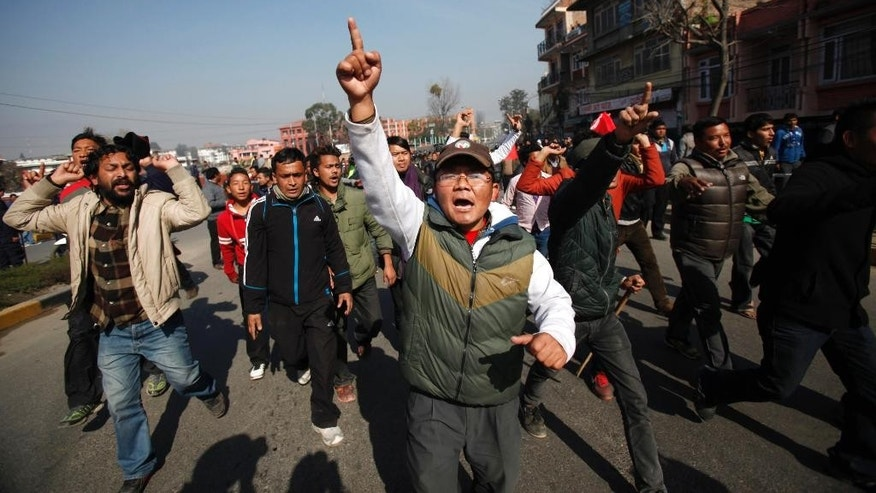 Nepalese protesters shout slogans against the government during the general strike called by alliance of 30 party led by Communist Party of Nepal (CPN-Maoist) in Kathmandu, Nepal, Tuesday, Jan 20, 2015. Opposition parties staged general strike to shut down Nepal on Tuesday as opposition politicians threw chairs and attacked the parliamentary speaker in a bid to block the government from pushing through a draft of a new constitution. (AP Photo/Niranjan Shrestha)