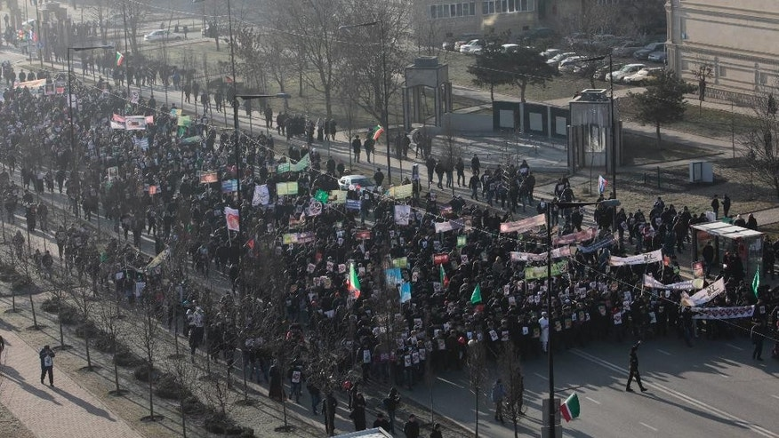Jan. 19, 2015: Chechen Muslims march in downtown regional capital of Grozny to take part in a protest rally. Tens of thousands of people have marched in the Russian region of Chechnya to rally against the French satirical magazine Charlie Hebdo.