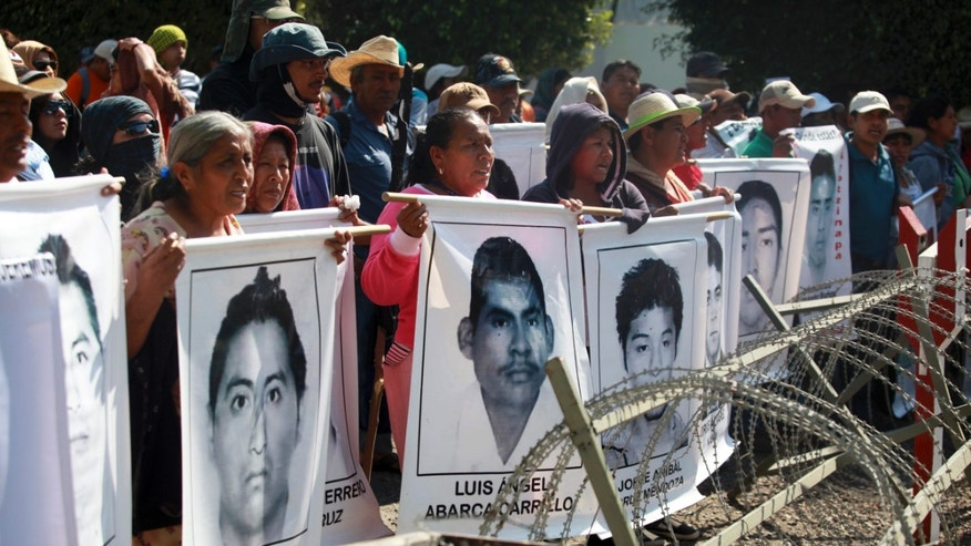 Relatives of missing students protest in Iguala, Mexico, on Dec. 18, 2014.