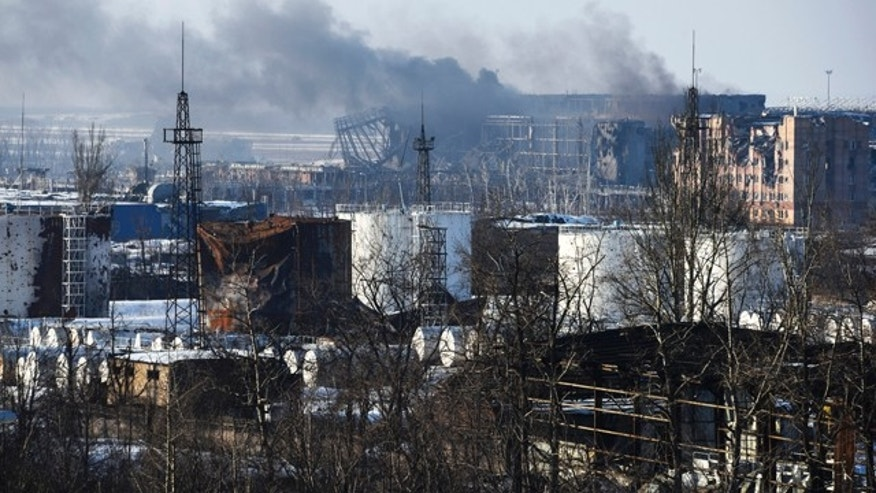 Jan.15, 2015: Smoke rises over the new terminal of Donetsk airport. (AP)