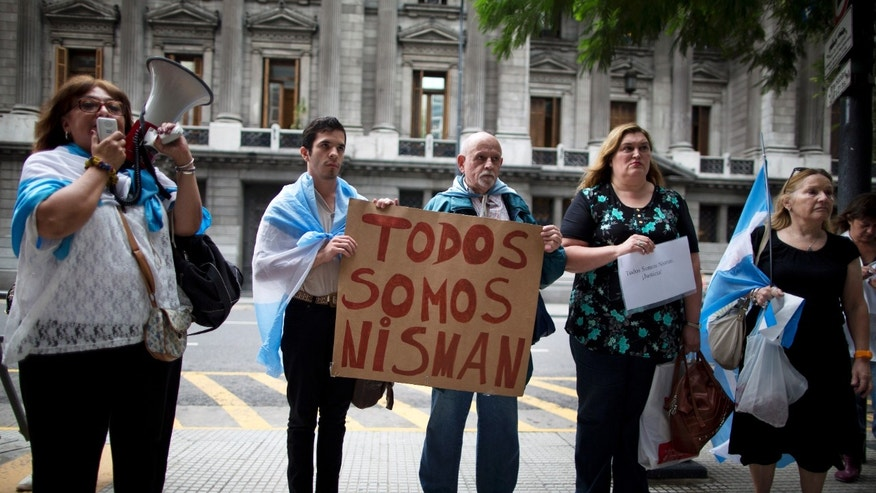 "People holding a sign that reads in Spanish ""We are all Nisman,"" protest the death of special prosecutor Alberto Nisman, outside Congress in Buenos Aires, Argentina, Monday, Jan. 19, 2015."