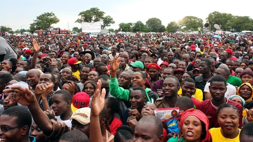 In this Sunday Jan. 18, 2015 photo, supporters of Zambia's leading opposition United Party for National Development (UPND) Hakainde Hichilema attend an election rally in Lusaka, Zambia. Zambians go to the polls Tuesday to elect a new president after the death of former President Michael Sata in October, 2014. (AP Photo/Moses Mwape)
