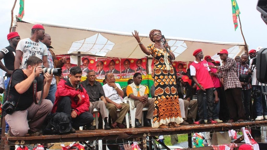 Supporter and party official Silver Masebo of Zambia's leading opposition United Party for National Development (UPND), led by Hakainde Hichilema, addresses an election rally in Lusaka Sunday, Jan. 18, 2015. Zambians go to the polls Tuesday, Jan. 20 to elect a new president Tuesday after the death of former president Michael Sata in October 2014. (AP Photo/Moses Mwape)