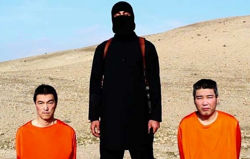 This image taken from an online video released by the Islamic State group's al-Furqan media arm on Tuesday, Jan. 20, 2015, purports to show the group threatening to kill two Japanese hostages that the militants identify as Kenji Goto Jogo, left, and Haruna Yukawa, right, unless a $200 million ransom is paid within 72 hours. Japan's Foreign Ministry's anti-terrorism section has seen the video and analysts are assessing it, a ministry official said on Tuesday. (AP Photo)