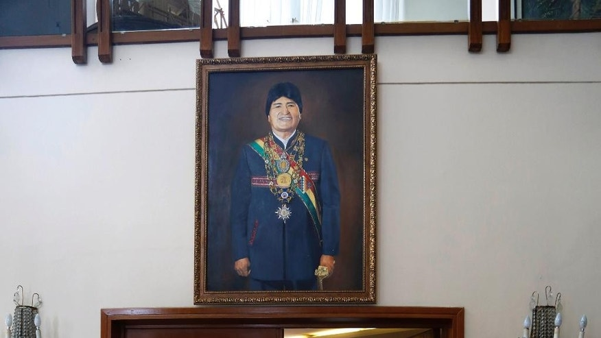 A painting of Bolivia's President Evo Morales hangs at the presidential residence in La Paz, Bolivia, Monday, Jan. 19, 2015. Supporters credit Morales with bringing Bolivia into the 21st century through public projects such as the launching of its first satellite and the opening of an Austrian-built aerial tramway system in the hilly capital. In October elections, more than 60 percent of voters backed him. But some now complain that the president, who grew up herding llamas and living in a dirt-floor adobe house, has grown too fond of the trappings of power. (AP Photo/Juan Karita)