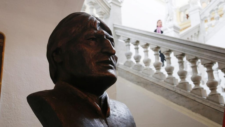 A bronze bust of Bolivia's President Evo Morales stands in the main entrance of Congress in La Paz, Bolivia, Tuesday, Jan. 20, 2015. Morales is set to begin a new term that will make him the Andean nation's longest-serving leader, riding high on a wave of unprecedented growth and stability. But as he prepares to take the oath Thursday, Morales and his countrymen face economic challenges that could quickly erode those gains and test the 55-year-old leader's popularity. (AP Photo/Juan Karita)