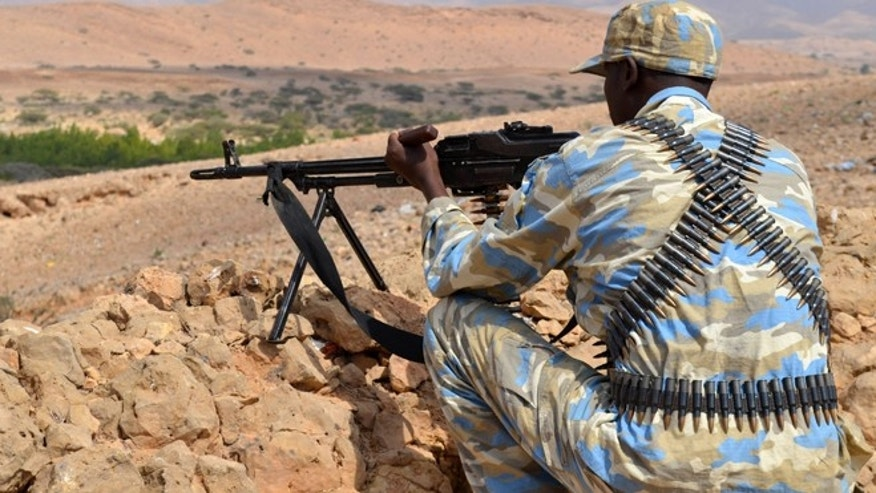 Jan. 8, 2015: A soldier from Somalia's Puntland keeps guard on high grounds at the Galgala hills, during preparations for an offense against al Shabaab militants, north of the capital Mogadishu.
