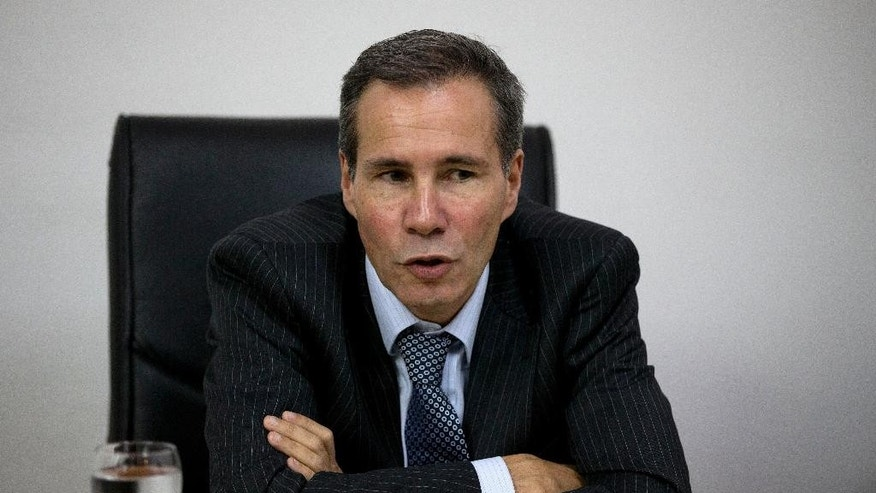 Police enter the building where late prosecutor Alberto Nisman had his office to gather evidence for the investigation into his death in Buenos Aires, Argentina, Tuesday, Jan. 20, 2015. Nisman, who had been investigating the 1994 bombing of the AMIA Jewish community center in Buenos Aires that killed 85 people and who accused President Cristina Fernandez of shielding Iranian suspects, was found dead with a gunshot to his head in the bathroom of his apartment late Sunday, hours before he was to testify in a Congressional hearing about the case. (AP Photo/Rodrigo Abd)