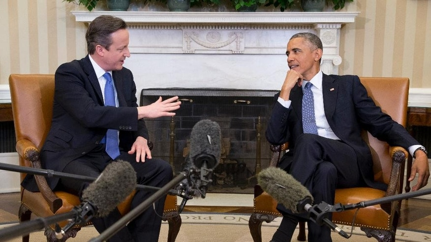 FILE - In this Jan. 16, 2015 file photo, President Barack Obama meets with British Prime Minister David Cameron, in the Oval Office of the White House in Washington. U.S. Sen. Lindsey Graham, a leading Republican critic of Obama's foreign policy, is pushing new sanctions against Iran over its nuclear program, unswayed by a White House veto threat and lobbying by Britain's leader.  (AP Photo/Carolyn Kaster, File)