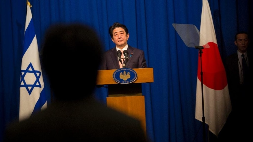 "Japan's Prime Minister Shinzo Abe, listens to a question during a press conference in Jerusalem, Tuesday, Jan. 20, 2015. The Islamic State group threatened to kill two Japanese hostages Tuesday unless they receive $200 million in 72 hours, directly demanding the ransom from Japan's premier during his visit to the Middle East. Abe vowed to save the men, saying: ""Their lives are the top priority."" (AP Photo/Sebastian Scheiner)"