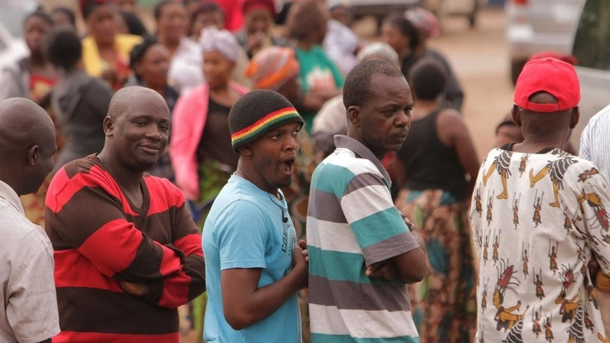 Zambians wait in a queue to cast their ballot on presidential election day in Lusaka, Tuesday, Jan. 20, 2015.  Zambians are voting to  choose a new leader following the death of Michael Sata, 77, who died Oct. 2014, in a London hospital following a long illness, after serving as President of the Southern African country since 2011. (AP Photo/Tsvangirayi Mukwazhi)