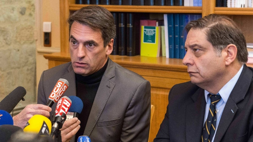 Jan. 20, 2015: Prosecutor Yvon Calvet, right, and a top police official in Montpellier, Gilles Souliers, address the media during a press conference held at the court house in Beziers, southern France.
