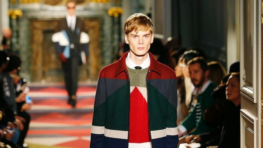 A model wears a creation by designer Valentino during his men's fall-winter 2015/2016 fashion collection presented in Paris, France, Wednesday, Jan. 21, 2015. (AP Photo/Jacques Brinon)