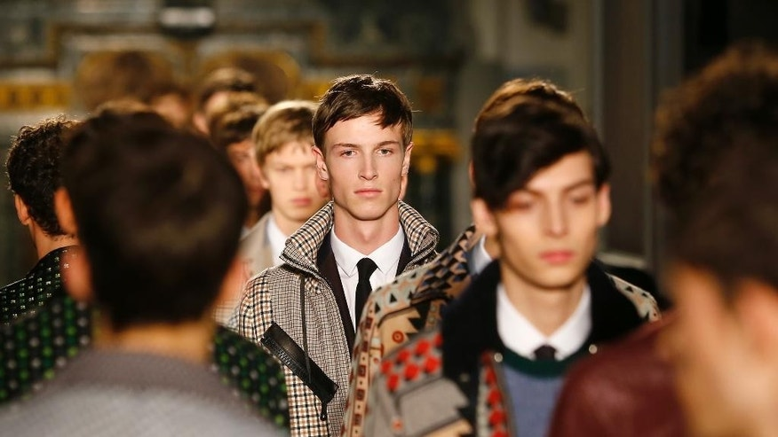Models wear creations by Valentino during his men's fall-winter 2015/2016 fashion collection presented in Paris, France, Wednesday, Jan. 21, 2015. (AP Photo/Jacques Brinon)