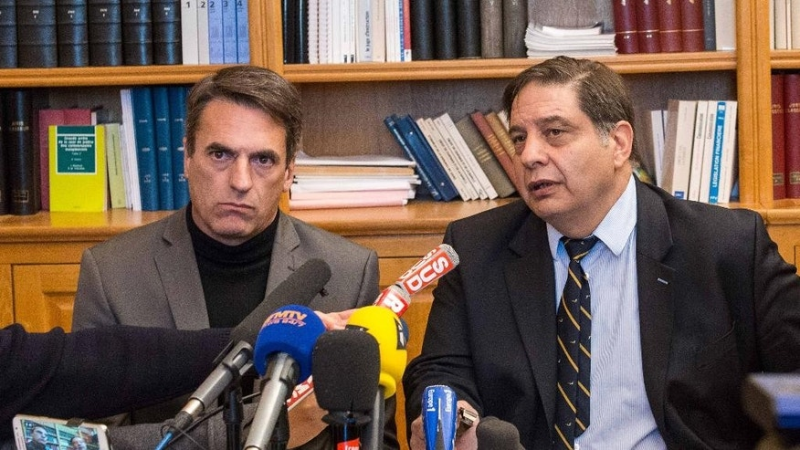 Prosecutor Yvon Calvet, right, and a top police official in Montpellier, Gilles Souliers, address the media during a press conference held at the court house in Beziers, southern France, Tuesday, Jan. 20, 2015. The mayor of the southern French town of Beziers says five Chechens have been arrested in the region, including one with a cache of explosives. Prosecutor Yvon Calvet told Midi Libre, the local paper, that it wasn't immediately clear whether a terror attack was planned. France has been on high alert since three days of terror in the Paris region left 20 people dead, including the three gunmen. (AP Photo/Jean-Paul Bonincontro)