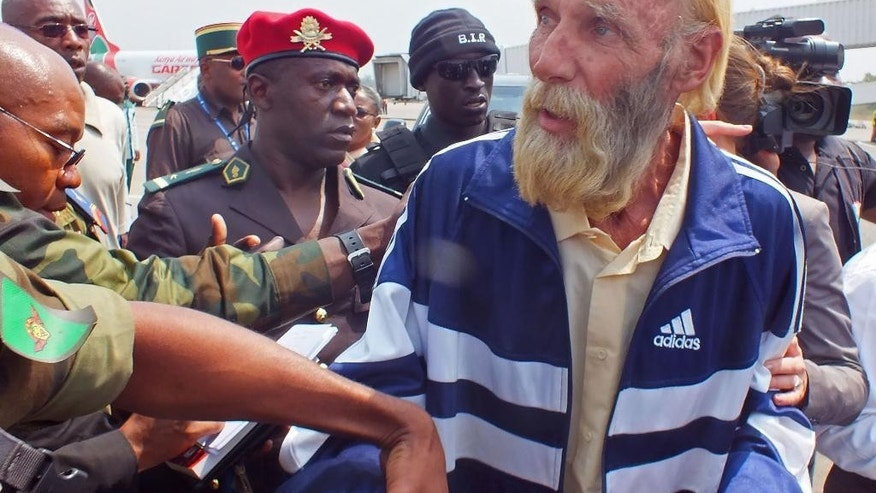 CAPTION CORRECTS THE NAME - Robert Nitsch Eberhard, a German citizen abducted and held hostage by suspected  Boko Haram militants, is seen as he arrives at the Yaounde Nsimalen International airport after his release in Yaounde, Cameroon, Wednesday, Jan. 21, 2015. Germany's Foreign Ministry says a German man believed to have been kidnapped in Cameroon by the Islamic extremist group Boko Haram has been freed. (AP Photo/Moki Edwin Kindzeka)