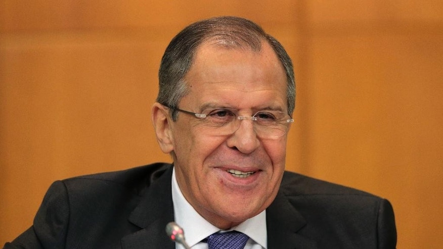 CAPTION CORRECTION, CORRECTS YEAR IN CAPTION - Russia's Foreign Minister Sergey Lavrov speaks at an annual news conference on Russia's foreign policy issues at the Foreign Ministry headquarters in Moscow, Wednesday, Jan. 21, 2015. Russia's foreign minister says talks with his counterparts from Ukraine, France and Germany will focus on pulling back heavy weapons from a redrawn frontline in east Ukraine. (AP Photo/Ivan Sekretarev)