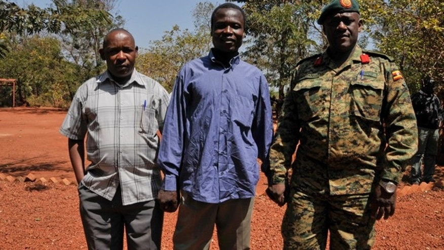 Jan. 16, 2015: A man said by the UPDF to be the wanted Lord's Resistance Army (LRA) commander Dominic Ongwen, center, stands with Ugandan Contingent Commander to the African Union Regional Task Force Col Michael Kabango, right, and another unidentified man, left, prior to being handed over by the UPDF to the African Union Regional Task Force who later handed him over to Central African Republic authorities in the Central African Republic. (AP Photo/Uganda People's Defence Force, Mugisha Richard)