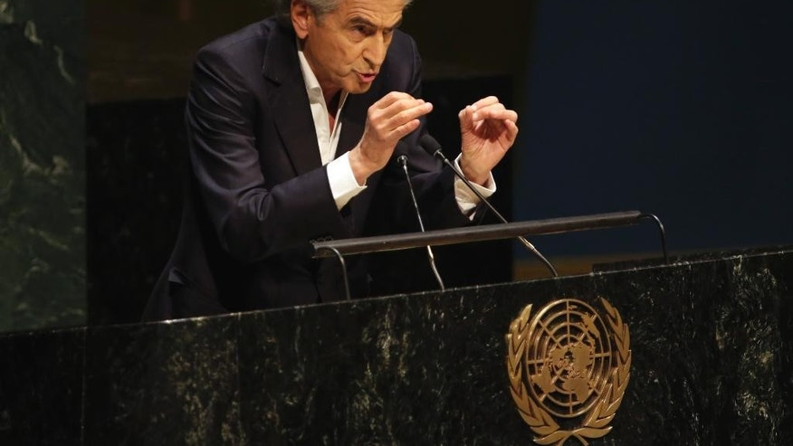 French philosopher and writer Bernard-Henri Levy addresses the United Nations General Assembly,  Thursday, Jan. 22, 2015. The U.N. General Assembly is holding its first-ever meeting devoted to anti-Semitism in response to a global increase in violence against Jews — a meeting scheduled even before the recent attack on a kosher supermarket in Paris. (AP Photo/Richard Drew)