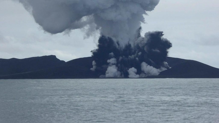 CORRECTS SOURCE - In this photo, taken Jan. 14, 2015 and released by New Zealand's Ministry of Foreign Affairs and Trade, a volcano erupts near Tonga in the South Pacific Ocean. A volcano that has been erupting for several weeks near Tonga has created a new island in the ocean. (AP Photo/New Zealand's Ministry of Foreign Affairs and Trade)