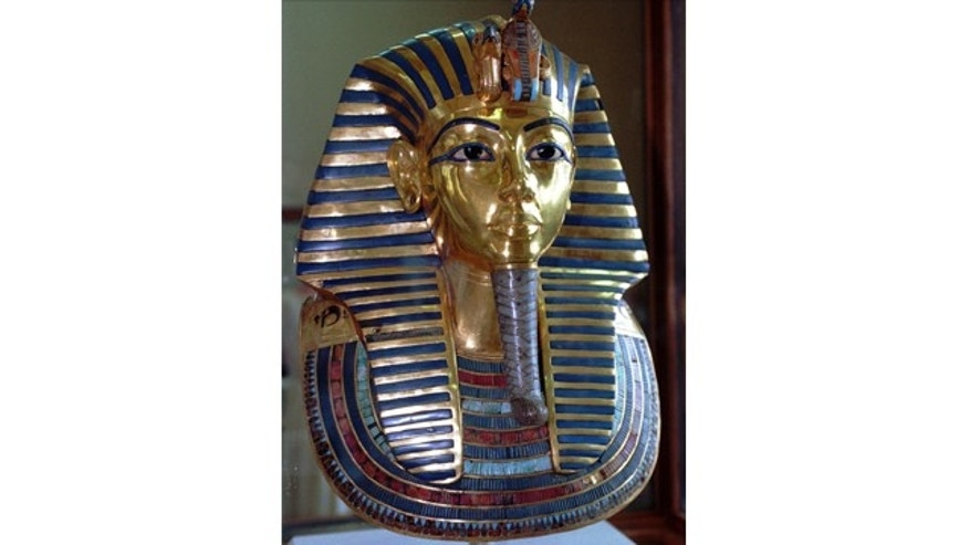 FILE - This July 1996 photo shows the mask of King Tutankhamun at the Egyptian Museum in Cairo. On Wednesday, conservators at the museum say the blue and gold braided beard on the artifact was hastily glued back on with epoxy after it was detached during a cleaning. (AP Photo/Mohamed El-Dakhakhny)