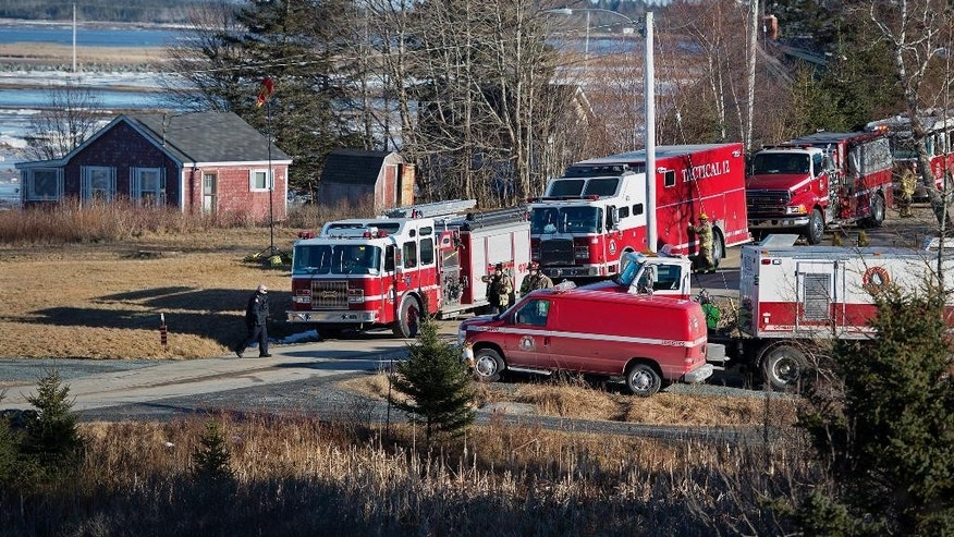 Firefighters work the scene where a large quantity of unidentified chemicals were found in a residence in Grand Desert, Nova Scotia, Wednesday, Jan. 21, 2015. A 42-year-old man, who was the subject of a Canada-wide warrant following an overnight investigation linked to the evacuation of two areas in Halifax where police found a large quantity of chemicals they have yet to identify, was taken into custody. (AP Photo/The Canadian Press, Andrew Vaughan)