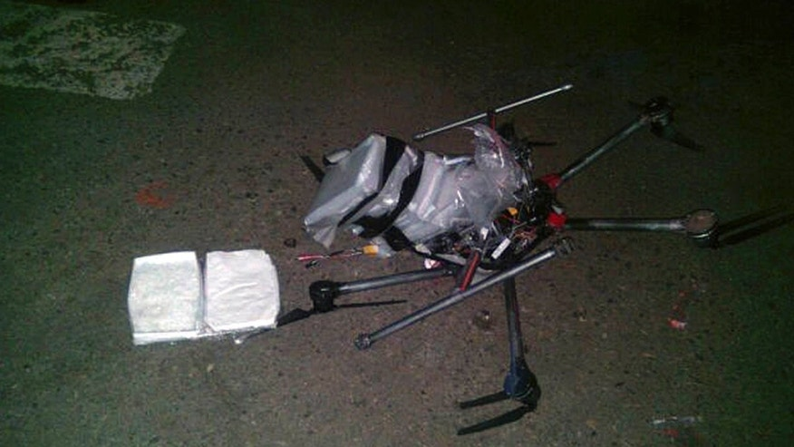 Jan. 20, 2015: A drone loaded with packages containing methamphetamine lies on the ground after it crashed into a supermarket parking lot in the city of Tijuana