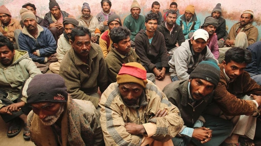 Indian fishermen sit in police custody in Karachi, Pakistan, Thursday, Jan. 22, 2015. A Pakistani police officer said the country's Maritime Security Agency has arrested 38 Indian fishermen for violating its waters in the Arabian Sea. (AP Photo/Fareed Khan)