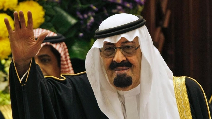 "FILE - In this Tuesday, March 24, 2009 file photo, King Abdullah bin Abdul Aziz al-Saud of Saudi Arabia, waves to members of the Saudi Shura ""consultative"" council in Riyadh, Saudi Arabia. On early Friday, Jan. 23, 2015, Saudi state TV reported King Abdullah died at the age of 90. (AP Photo/Hassan Ammar)"