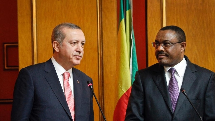Turkey's President Recep Tayyip Erdogan, left, and Ethiopia's Prime Minister Hailemariam Desalegn, speak to the media after a bilateral meeting in the capital Addis Ababa, Ethiopia Thursday, Jan. 22, 2015, during the Turkish President's visit to Ethiopia. A suicide car bomber blew himself up at the gate of a hotel which was being used by a delegation of Turkish officials Thursday in Somalia's capital Mogadishu, killing three Somalis and shattering windows, and coming one day before Turkish President Recep Tayyip Erdogan was due to arrive in the Somali capital. (AP Photo/Elias Asmare)