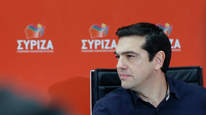 In this Wednesday Jan. 14, 2015 photo, Alexis Tsipras, head of Greece's Syriza left-wing main opposition party, waits for an online interview on his electoral platform at the party offices in Athens.  His left-wing Syriza party is poised to win a general election in Greece Sunday, a landmark event for Europe's ambitious political newcomers with domestic resonance in a country with a long history of deadly political division that has recently been ravaged by financial crisis. (AP Photo/Thanassis Stavrakis)