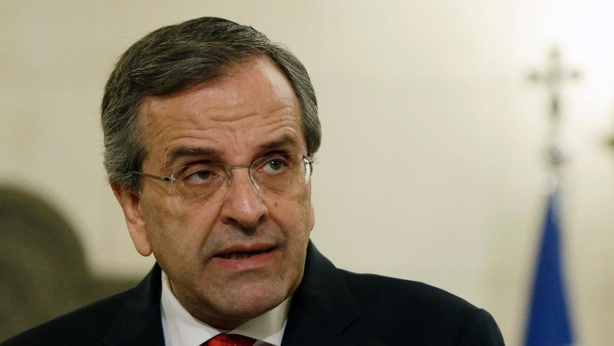 This photo taken on Wednesday, Jan. 14, 2015 shows Greece's Prime Minister Antonis Samaras, 63, makes statements at Maximos Mansion in Athens. Greece goes to the polls on Sunday, Jan. 25, 2015 in a snap general election as the country was showing tentative signs of emerging from a deep financial crisis that has disturbed the eurozone. The vote, held more than a year early, has once more raised the specter of Grexit _ a Greek exit from Europe's joint currency. (AP Photo/Thanassis Stavrakis)