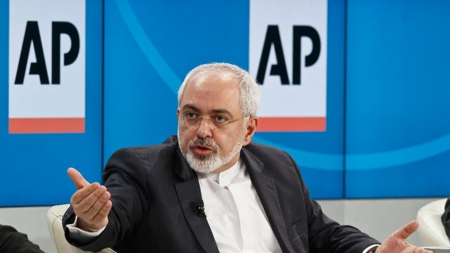 "Iranian Foreign Minister Mohammad Javad Zarif, gestures as he speaks during a panel discussion ""The  Geopolitical Outlook"" at the World Economic Forum, Friday, Jan. 23, 2015.  The world's financial and political elite will head this week to the Swiss Alps for 2015's gathering of the World Economic Forum at the Swiss ski resort of Davos. (AP Photo/Michel Euler)"