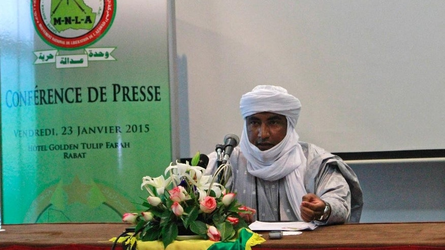 Mossa Ag Attaher, the spokesman for the National Movement for the Liberation of Azawad, speaks at a press conference in Rabat, Morocco, on Friday Jan. 23, 2014.   The Tuareg separatist spokesman Mossa Ag Attaher accused the U.N. peacekeeping mission in Mali of siding with the government and allied militias and has threatened to boycott upcoming peace talks based in Algeria. (AP Photo/ Paul Schemm)