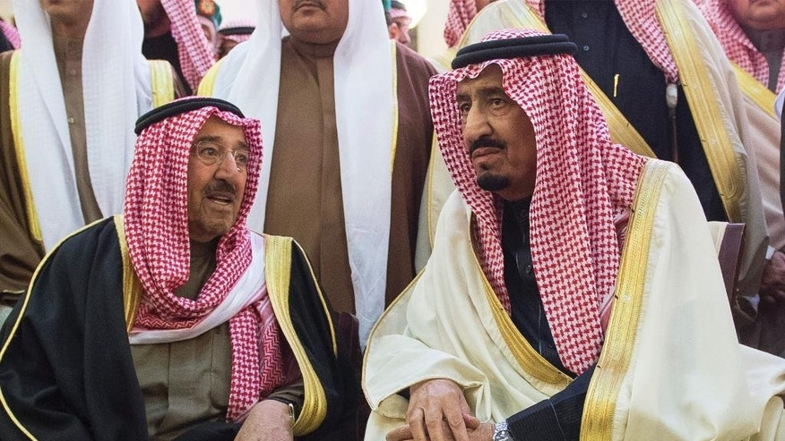 In this photo provided by the Saudi Press Agency, Saudi Arabia's newly enthroned King Salman, right, talks with Kuwait's Emir Sheikh Sabah Al-Ahmad Al-Jaber Al-Sabah during the funeral of Salman's half brother King Abdullah at the Imam Turki bin Abdullah mosque in Riyadh, Saudi Arabia, Friday, Jan. 23, 2015. Saudi state TV reported early Friday that King Abdullah died at the age of 90. (AP Photo/SPA)