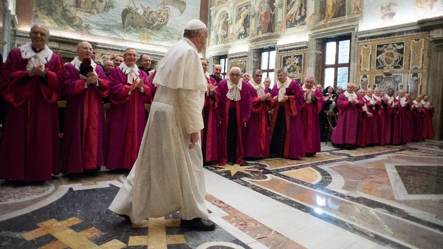 Pope Francis, foreground, walks past members of the Vatican tribunal, Roman Rota, on the occasion of the opening of the judicial year at the Vatican, Friday, Jan. 23, 2015. (AP Photo/L'Osservatore Romano, Pool)