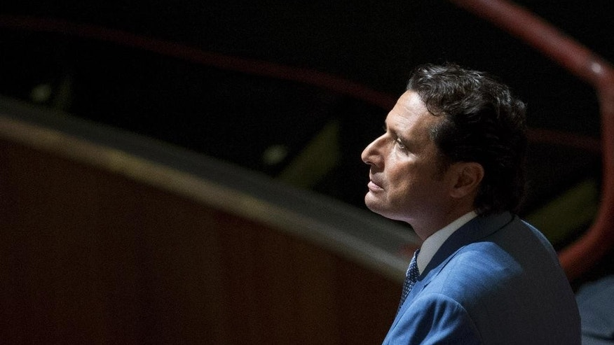"""FILE -- In this file photo taken on Sept. 24, 2013 Captain Francesco Schettino waits for the arrival of the judges in the court room of the converted Teatro Moderno theater at the end of a pause of his trial, in Grosseto, Italy. A prosecutor in the trial for the shipwreck of the Costa Concordia contends that 32 people died not because the luxury cruise liner crashed into a reef, but due to """"chaos, delays, errors"""" under the captain's watch. Prosecutor Alessandro Leopizzi was making final arguments Friday in the trial in Grosseto, Tuscany, of Francesco Schettino, who captained the Italian liner which capsized near tiny Giglio island in 2012. (AP Photo/Andrew Medichini)"""